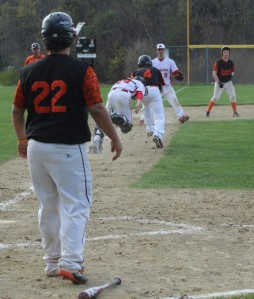 Luke Sirois (#4) caught in a rundown by catcher Johnny Prentice