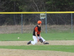 Ball goes through second baseman Liam Sullivan