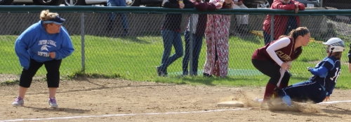 Taylor Johnson tagged out at third base by Meg Stanton as Triton coach Michele Brewer watches