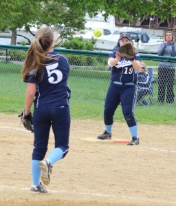 Triton pitcher Haley Johnson throws to 1B Lilly Anderson