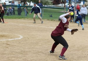 Meg Stanton sets to throw out baserunner Shannon Lyons