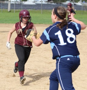 Shianne Sneider (one RBI) reaches 3B as Emma McGonagle awaits the throw
