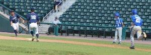 Nick Cervizzi flips to pitcher Kyle Rafferty