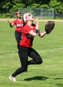 Lauren Fedorchak runs down a foul popup
