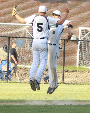 Ryan Kuchar and Bobby Barry celebrate the win over Lynnfield