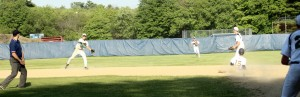 Shortstop Pat Beaton throws to first for the final out