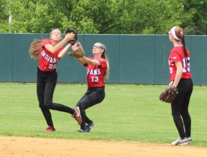 Maddie Napoli (25) and Sam Stone (13) chase the same popup