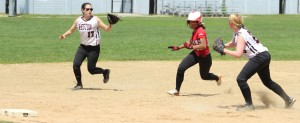 Alexis Boswell caught between Naomi Siverstein (#17) and Marie McMann