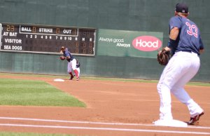 shortstop Ryan Dent sets to throw to first
