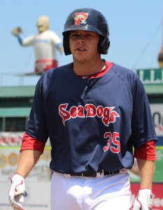 Danny Bethea returns to the Portland dugout after getting an RBI in his first at-bat with the Sea Dogs