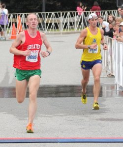 battle for 9th in the 10 mile between Anthony Walsh (left) and Ian Nurse (right)