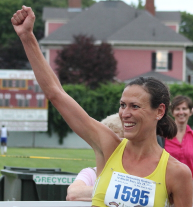 Katie Misuraca celebrates being top finisher among women in the ten mile