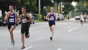 Nathaniel Webber (2446), Joe Santo (2936), and Stephen Leonard (1327) chase the leaders in the 5K