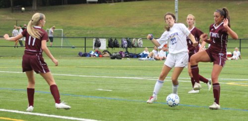Makenna Cerney gets into position to score the first Newtown goal