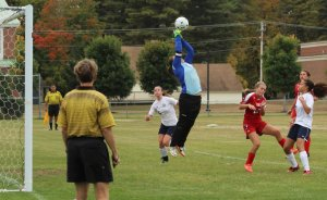 GNG goalie Zoe Adams jumps for a save