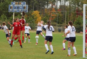 Emma Woods (8) nods in the first Patriots goal