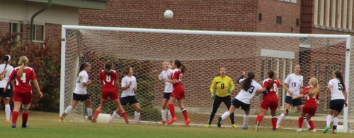 Maria Valente (18) in position to head in a goal