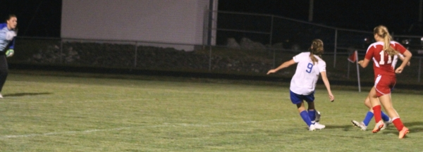 Sophomore Kristen Huntress sets to rip home the game-winner with 23 seconds left.