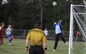 Patriots goalie Zoe Adams tips a shot over the net