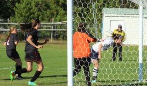 Julia Quinn heads home a first-half goal