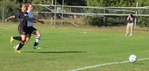 Julia Quinn drives home her first goal despite close guarding by Emily Baker