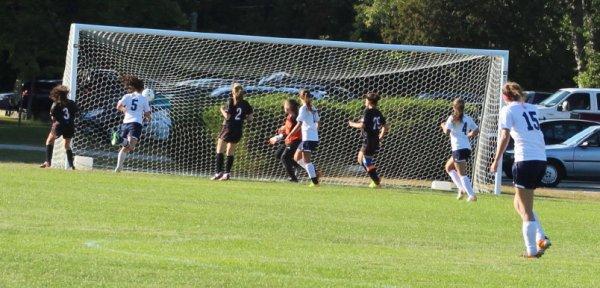 Julia Quinn (#5) heads in a second-half goal