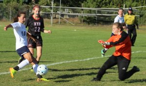 NYA goalie Scout Fischman tries to stop Anna Manahor