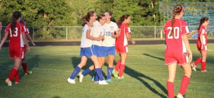 Megan Boos, Kaylyn Jordan, and Lauren Jakobs celebrate first goal