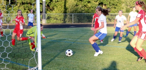 Megan Boos about to score the first Lake Region goal with an assist to #1 Kaylyn Jordan