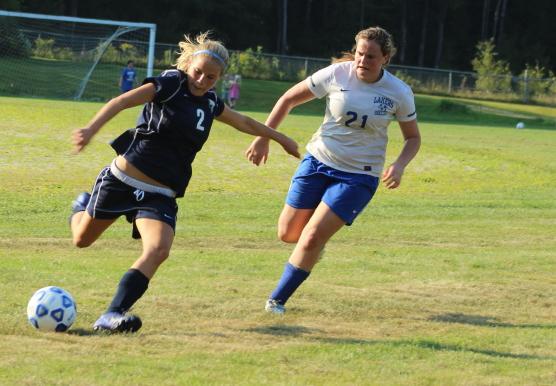 Plenty of scoring chances for York.  Here Paige McElwain shoots as Devin Langadas pursues.