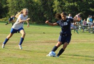 Lindsey Cole chased by freshman Danica Chadwick