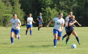 Devynn Turner (#22) tries to beat Maddie Amidon to the ball