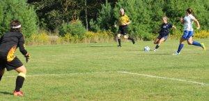 Sophomore Kate Marshall lines up a shot on GK Isabel Scribner