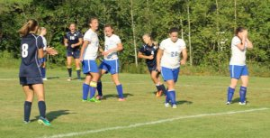Players react to the goal scored by #4 Elaine Cavalieri