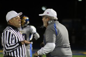 BHS coach Rich Angarano questions the roughing the kicker call