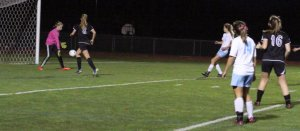 Caitlyn Winn shoots the 7th Windham goal
