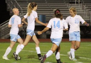 Jenna Soucy (3 goals) congratulates Caitlyn Winn after she scored the 7th Windham goal