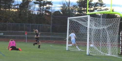 Ciera Berthiaume slides by the Marshwood goal after scoring in the first twenty seconds.