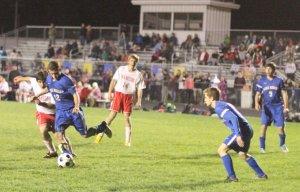 Kolin Wyman (12) clears the ball away for Lake Region