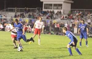 Kolin Wyman (12) clears the ball away for Lake Region