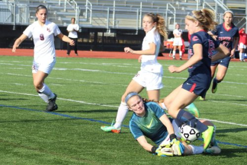 lice A11 GK Caroline Fay slides to block