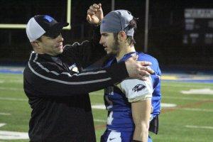 Coach Steve George and Ethan Carpenter