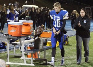 Jacob Burden leaves at halftime with trainer
