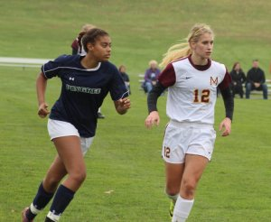Sophomore Olivia Pena keeps a close eye on 40-goal scorer Caroline Soucy