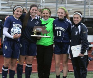 Winthrop captains and Coach Tracey Martucci with runnerup trophy