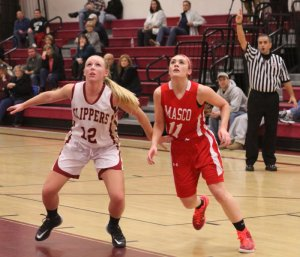 Morgan Johnston and Lauren Sorel (13 points) look for a rebound