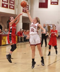 Morgan Johnston (12) blocks a shot