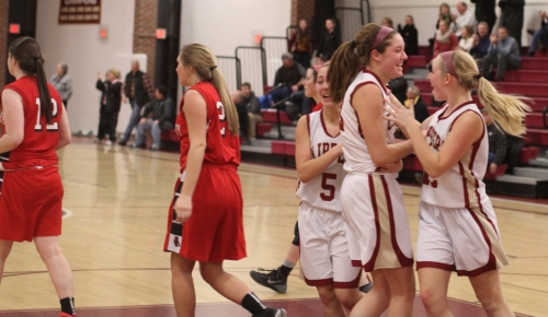 Olivia Olson and Morgan Johnson surround Emily Pettigrew after her game-winner