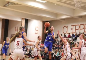 Maya Spence (17 points) gets airborne in the lane