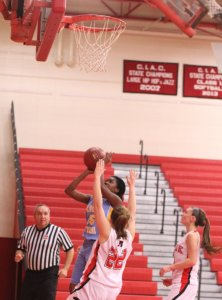 Nia Fogle (14 points) in for two